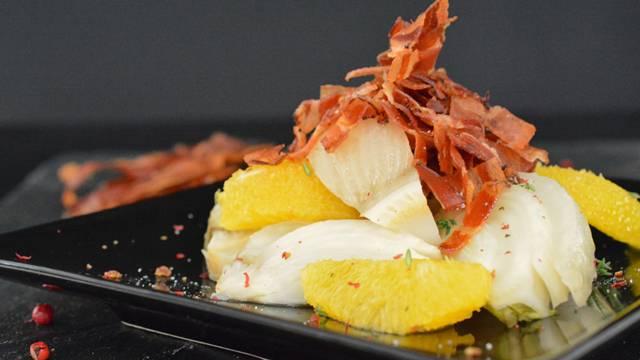 Fenouil braisé aux oranges et au lard grillé